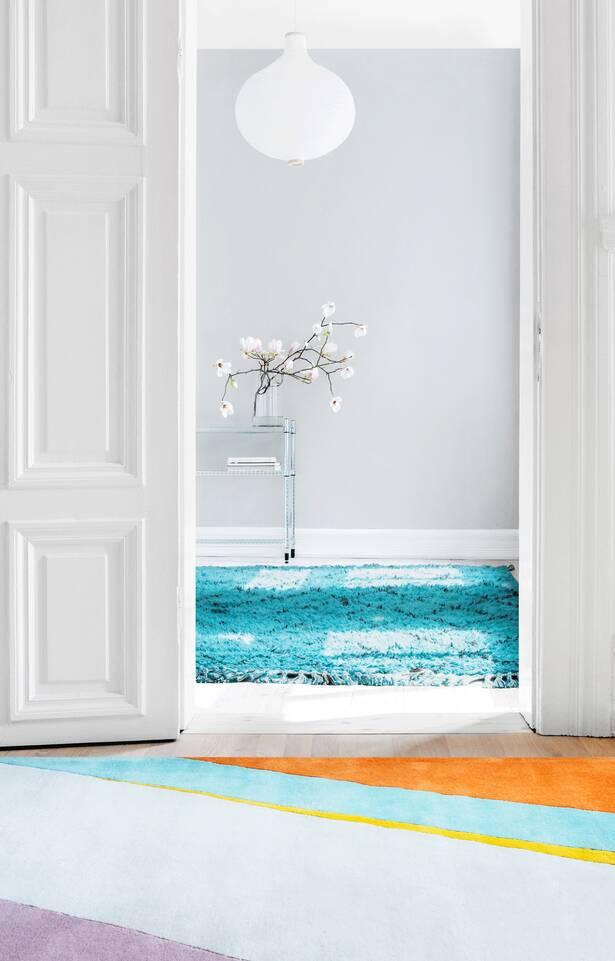 Weißer  Handtufted - Teppich in einem Wohnzimmer
